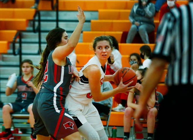 Ashland's Kaylee Friesen (30) tries to back down Loudonville's Maddie Kline (22) during the Arrows' 70-47 loss Thursday at Arrow Arena.
