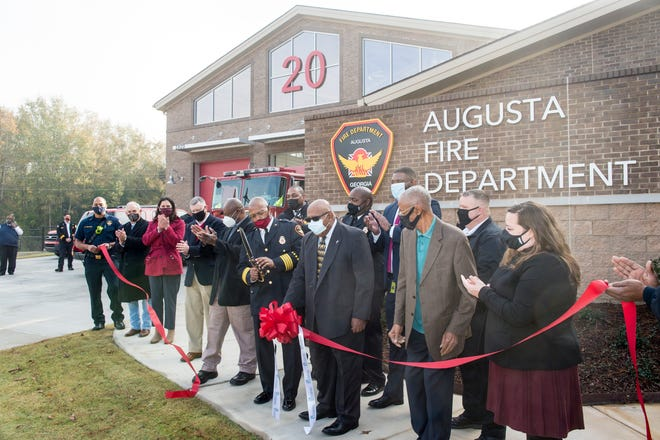 Interim Augusta Fire Chief Shaw Williams Jr. (with scissors) is joined by local officials to cut the ribbon to officially open the new Fire Station No. 20 at 2820 Old Highway 1 on Friday morning.
