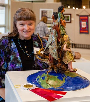 """Angelika Selman-Bondar exhibited her clay sculpture, """"Mother Earth's Children"""" at a recent North Augusta Artists Guild show."""