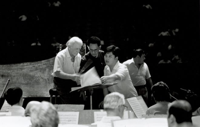 The late Philadelphia Orchestra Conductor Eugene Ormandy (left) and Chinese pianist Yin Chengzong (right) discuss music with a translator during the orchestra's visit to China.  A documentary on the orchestra's relationship with China will be livestreamed Wednesday for the 250th birthday of composer Ludwig van Beethoven.