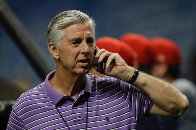 Boston Red Sox GM Dave Dombrowski talks on the phone prior to a 2019 game.