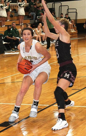 Merryville's Maddie Mahfouz (right) attempts to slow down Hicks' junior Lauren Quinn (with ball) during action Tuesday. Quinn and the Lady Pirates beat Mahfouz and the Lady Panthers, 69-41.