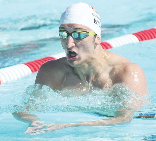 Preston Willis, shown earlier in his swimming career, came away from Tuesday's meet with three championships —one individual and two on relays.
