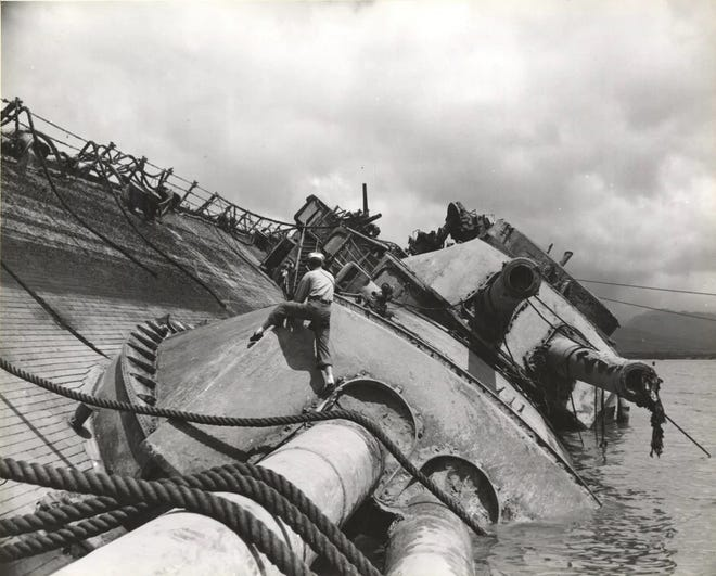 The USS Oklahoma was sunk by several bombs and torpedoes during the Japanese attack on Pearl Harbor on Dec. 7, 1941. A total of 429 crew died when the ship capsized.