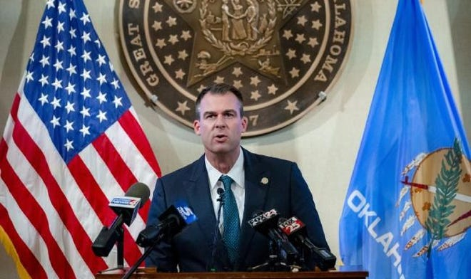 Gov. Kevin Stitt speaks during a press conference at the state Capitol building to provide an update on Oklahoma's response to COVID-19 in Oklahoma City, Okla. on Thursday, Dec. 10, 2020.