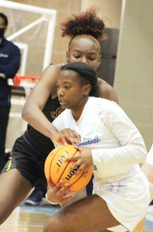 T'Keitha Valentine, left, has been a steady force for the Bartlesville High School girls basketball team during a challenging start.