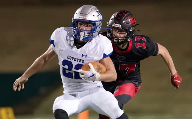 Landon Burkhart gains yards in the Class 1A Division 2 state semifinal game on Dec. 6 in Abilene.