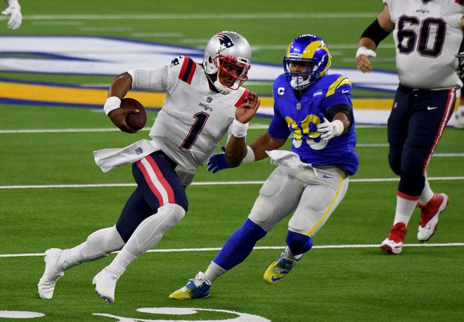 Rams defensive end Aaron Donald pressures New England Patriots quarterback Cam Newton in the first half of Thursday's game.