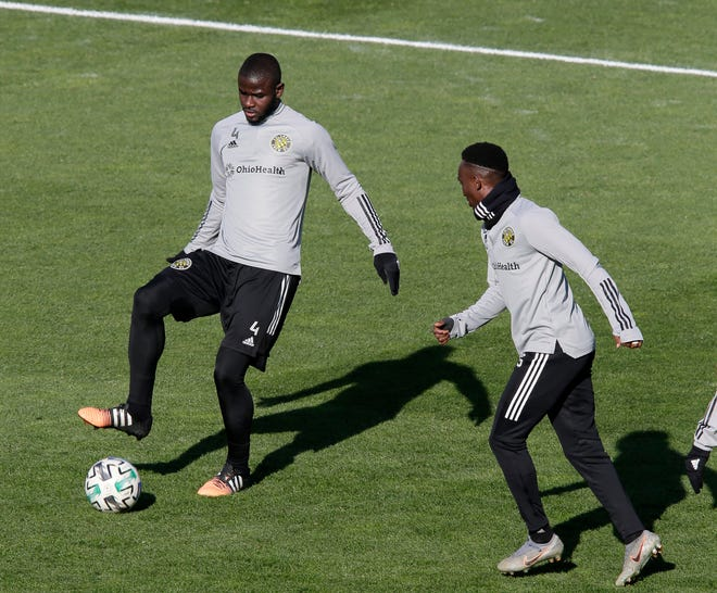 Columbus Crew players Jonathan Mensah, left, and Harrison Afful practice at Mapfre Stadium in Columbus, Ohio on Friday.