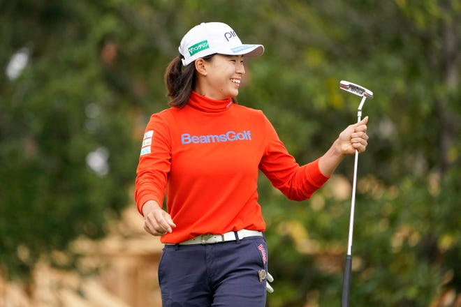 Hinako Shibuno smiles after putting on the 17th green during the second round of the U.S. Women's Open in Houston on Friday.