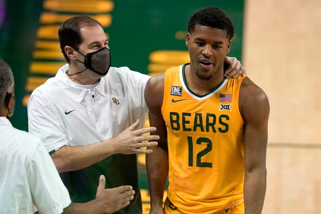 Baylor coach Scott Drew talks with guard Jared Butler during a game against Stephen F. Austin on Wednesday.
