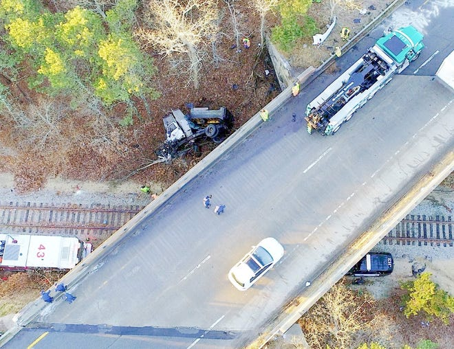 A westbound section of Route 6 in South Yarmouth was partially closed Friday morning after a truck went off the overpass and crashed onto the railroad tracks below. The driver suffered possiblelife-threatening injuries.