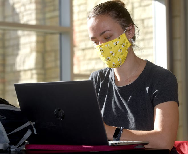 Frannie Wilkinson, 24, a graduate student from Kansas City, studies nutrition sciences on Thursday at the MU Student Center. Wilkinson had to quarantine for two weeks after her boyfriend tested positive for COVID-19.