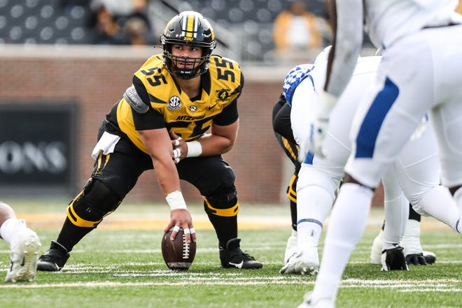 Missouri center Michael Maietti (55) prepares to snap the ball during a game against Kentucky on Oct. 24 at Faurot Field.