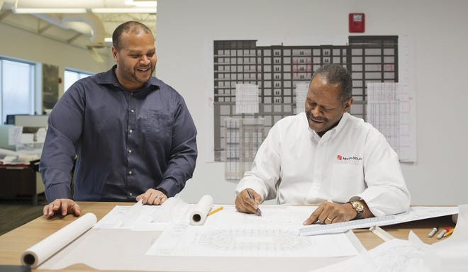 Jonathan Moody, left, this year took over the CEO role at Moody Nolan architectural firm from his father and founder, Curt Moody, right.