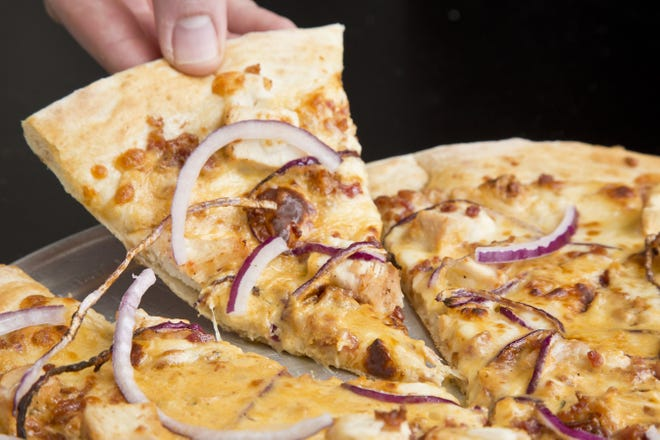 The It's Smokin Gouda pizza comes with bacon bits, wispy onions and creamy-and-tangy cheese.