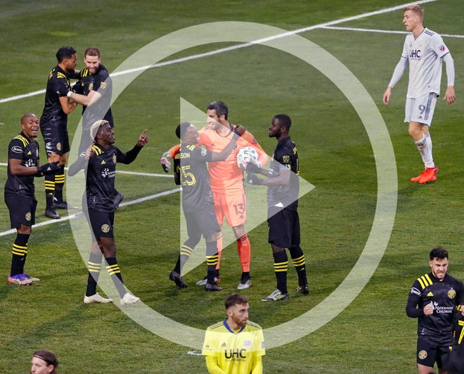 In this file photo, Columbus Crew SC celebrate after beating New England Revolution 1-0 in the MLS Eastern Conference Final at MAPFRE Stadium in Columbus, Ohio on December 6, 2020.