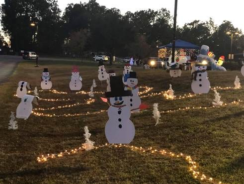Seminole Springs Elementary hosted a drive-thru Snowman Village to provide students a little bit of fun while also doling out homework for the break and engaging them in educational activities.