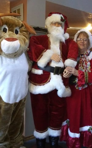 Rudolph, Santa and Mrs. Claus will be on hand waving to kids as they pick up their stockings.