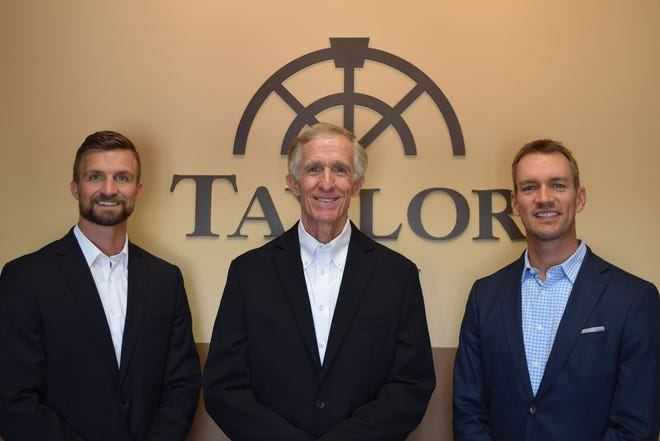 Austin Taylor, principal and employee benefits, stands with his father, Dave Taylor, and Matt Yost, principal and business risk advisor. The Taylors are the fourth and third generation owners of the Taylor Agency in Wooster.