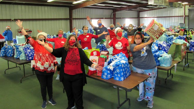 Staging at Cattleman's Hall, volunteers and staff of the Flagler Volunteer Services host the 28th Annual Giving Store.