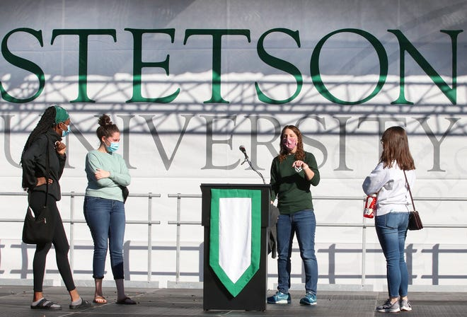 Julie Hunter, Director of University events, center, gives instructions to student speakers Ifrom left) Heyley Gatewood, Maria Toledo and Tara Tovkach during rehearsal for Stetson University's 134th commencement on Friday, December 11, 2020.