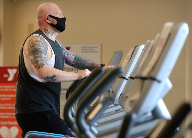 Matthew Gurcza, of Erie, works out on an elliptical machine Friday at the Glenwood YMCA in Erie. Pennsylvania gyms will be closed beginning Saturday due to the latest temporary state COVID-19 mitigation guidelines outlined Thursday by Gov. Tom Wolf.