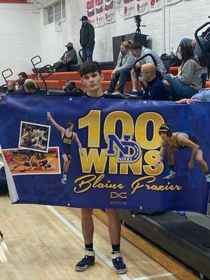 Notre Dame-West Burlington/Danville junior wrestler Blaine Frazier picked up his 100th career win Thursday at Van Buren County High School.