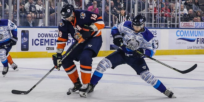 Greenville Swamp Rabbits forward Nathan Perkovich (18), left, and Icemen forward Chase Witala (8) vie for the puck during a 2019-20 game. Perkovich is now part of the roster of the Icemen, who play Greenville in their home opener on Saturday night.