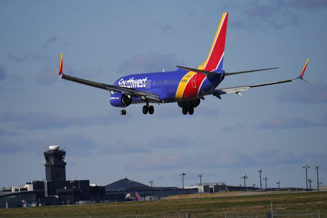 A Southwest Airlines flight from Bradley International Airport makes its landing approach onto Baltimore-Washington International Thurgood Marshall Airport, Monday, Nov. 23, 2020, in Glen Burnie, Md.