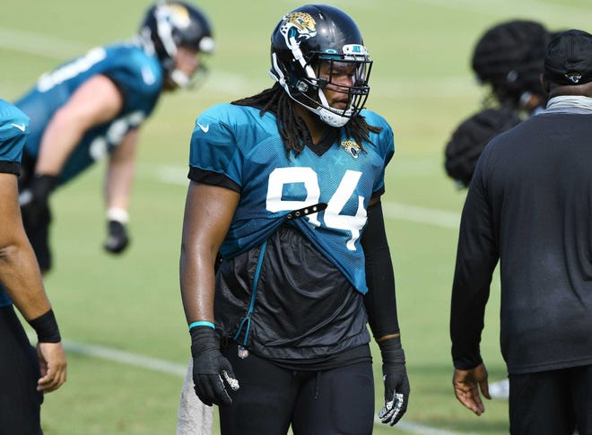 Jaguars defensive lineman Dawuane Smoot (94) stands on the field during conditioning drills.