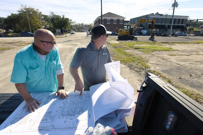 Joe Bryant and Russell Morgan from Miranda Contracting look over site plans for the infrastructure their company is installing for a long-delayed Publix supermarket at Hendricks Avenue and Atlantic Boulevard in San Marco.