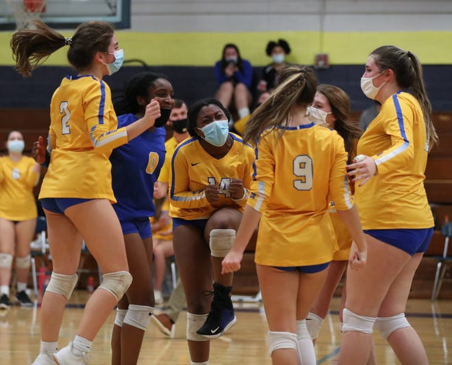 The Highland Rams volleyball team celebrate after winning the second set in December's conference match against Lincoln Charter. (Brian Mayhew / Special to the Gazette)