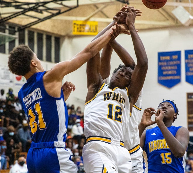 Winter Haven's Isaac Celiscar get the ball swatte away by Auburndale's Isaiah McClain. Both Winter Haven and Auburndale were scheduled to play in shootouts this weekend.
