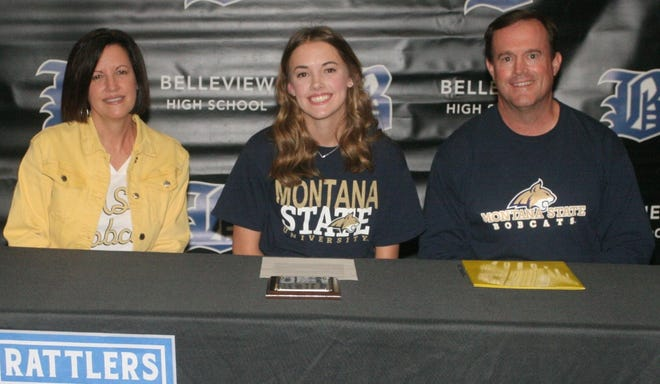 Belleview volleyball standout Maci Abshier, center, signed a National Letter-of-Intent with Montana State University on Thursday, as mother, Selena, and father, Emery, look on.