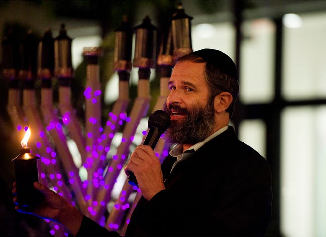 Rabbi Moshe Scheiner of the The Palm Beach Synagogue celebrates the first night of Chanukah with a menorah lighting at The Royal Poinciana Plaza on Friday. MEGHAN MCCARTHY/THE PALM BEACH DAILY NEWS