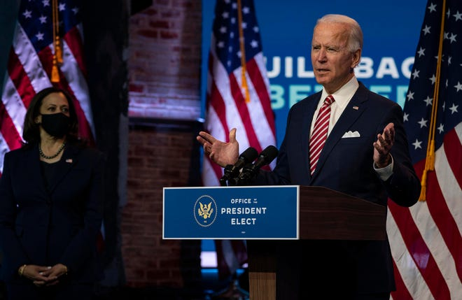 President-elect Joe Biden speaks about the economic recovery from the coronavirus pandemic as Vice President-elect Kamala Harris watches, at The Queen theater in Wilmington, Del., in November. [Ruth Fremson/The New York Times]