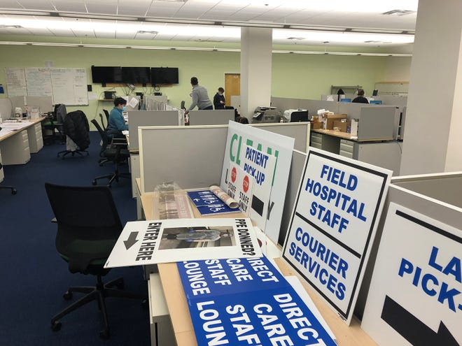 The scene inside the back offices of the Kent field hospital in Cranston on Thursday. This is the nerve center of the field hospital, where doctors, nurses, engineers and many other professionals meet to make the place run smoothly.