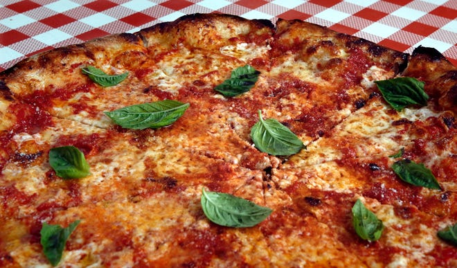 The house cheese pizza at Pizza Marvin has triple mozzarella cheese.  The Pizzeria opened last week on Wickenden Street in Providence.