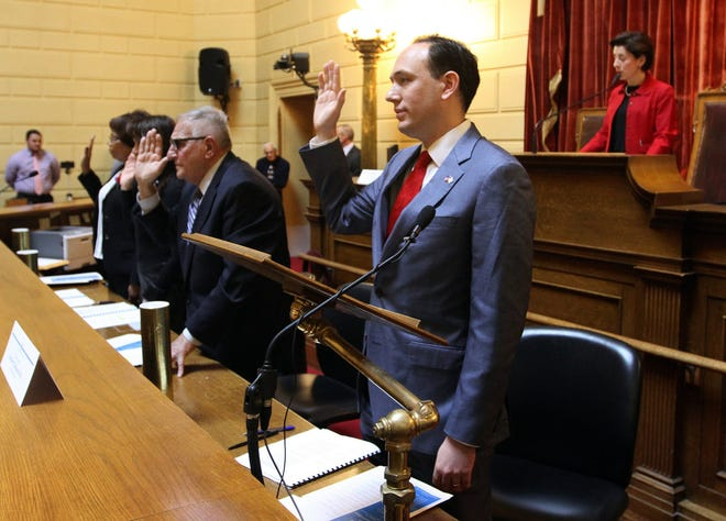 Rhode Island electors cast their votes for president and vice president in 2016. From left are Rep. Grace Diaz, L. Susan Weiner, Frank J. Montanaro and Herbert Claiborne Pell.