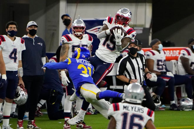 New England Patriots wide receiver N'Keal Harry, top, makes a catch over Los Angeles Rams defensive back Darious Williams during the second half of an NFL football game Thursday, Dec. 10, 2020, in Inglewood, Calif.
