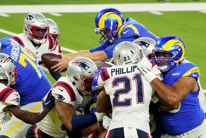 Los Angeles Rams quarterback Jared Goff, top, lunges into the end zone to score a touchdown during the first half of an NFL football game against the New England Patriots Thursday, Dec. 10, 2020, in Inglewood, Calif. (AP Photo/Ashley Landis) ORG XMIT: CAMS104