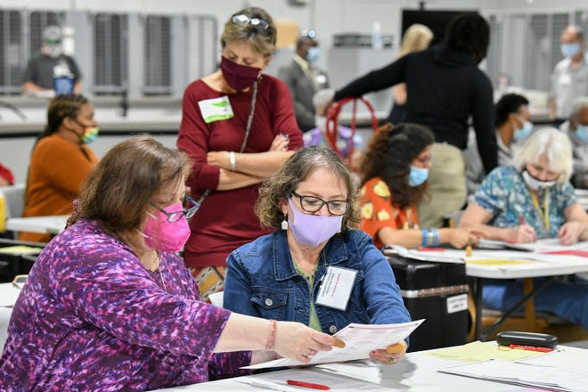 Election workers in Gwinnett County, Georgia, help with a recount of 414,000 ballots -- nearly 10 percent of all votes cast in the state -- on Nov. 13, 2020.