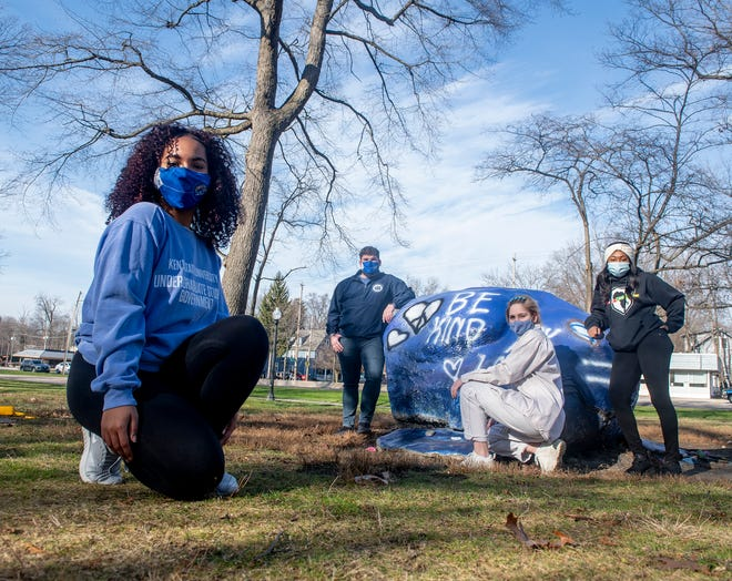 """Tiera Moore, student body president, with Brandon Taylor, director of student advancement; Isabella Alvarino, freshman intern; and Tayjua Hines, president Black United Students would encourage rock painters to """"be kind"""" in their messages."""