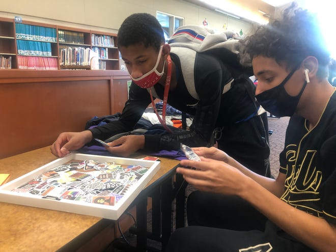 Kaiilen Warren, a 9th grader at Ravenna High School, and Dominic Wilcox, who is in 10th grade, look at Black Lives Matter stickers. The high school is working to establish a Black Lives matter club.
