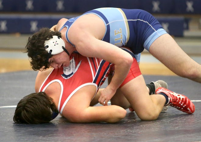 Brenden Severs (top) of Louisville defeated Easton Cook of Indian Valley in a 182-pound bout at Louisville on Thursday, Dec. 10, 2020.
