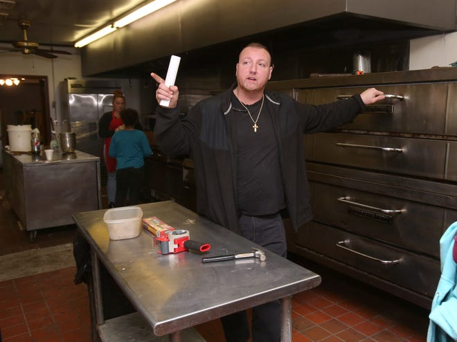 Michael DeChellis stands next to the pizza ovens in the kitchen of the former Lucia's restaurant in Canton. DeChellis wants to continue the family's restaurant business, which his father Phil deChellis started in Canton's downtown, at Lucia's former location on the northeast side.