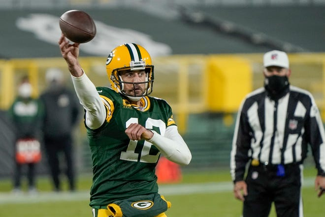 Green Bay Packers quarterback Aaron Rodgers throws a touchdown pass during the second half against the Philadelphia Eagles on Dec. 6 in Green Bay, Wis. The Packers could clinch the NFC North title with a win Sunday against Detroit.