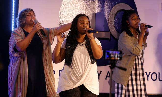 Singers use their voices in worship at Destiny Life Center. [Brittany Randolph/The Star]