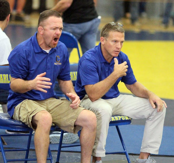 Charlotte coach Evan Robinson, left, reacts in the semifinal round at the Captain Archer Memorial Wrestling Tournament